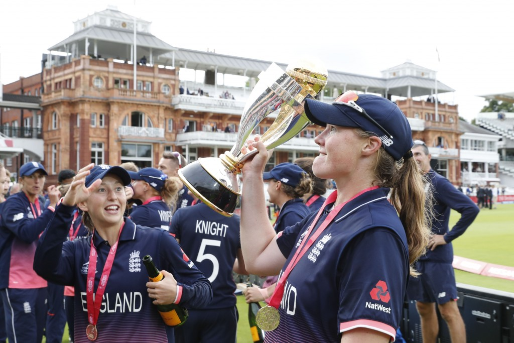 Anya Shrubsole holds the trophy - AFP