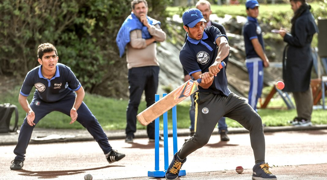 Refugees take northern French town to cricket glory