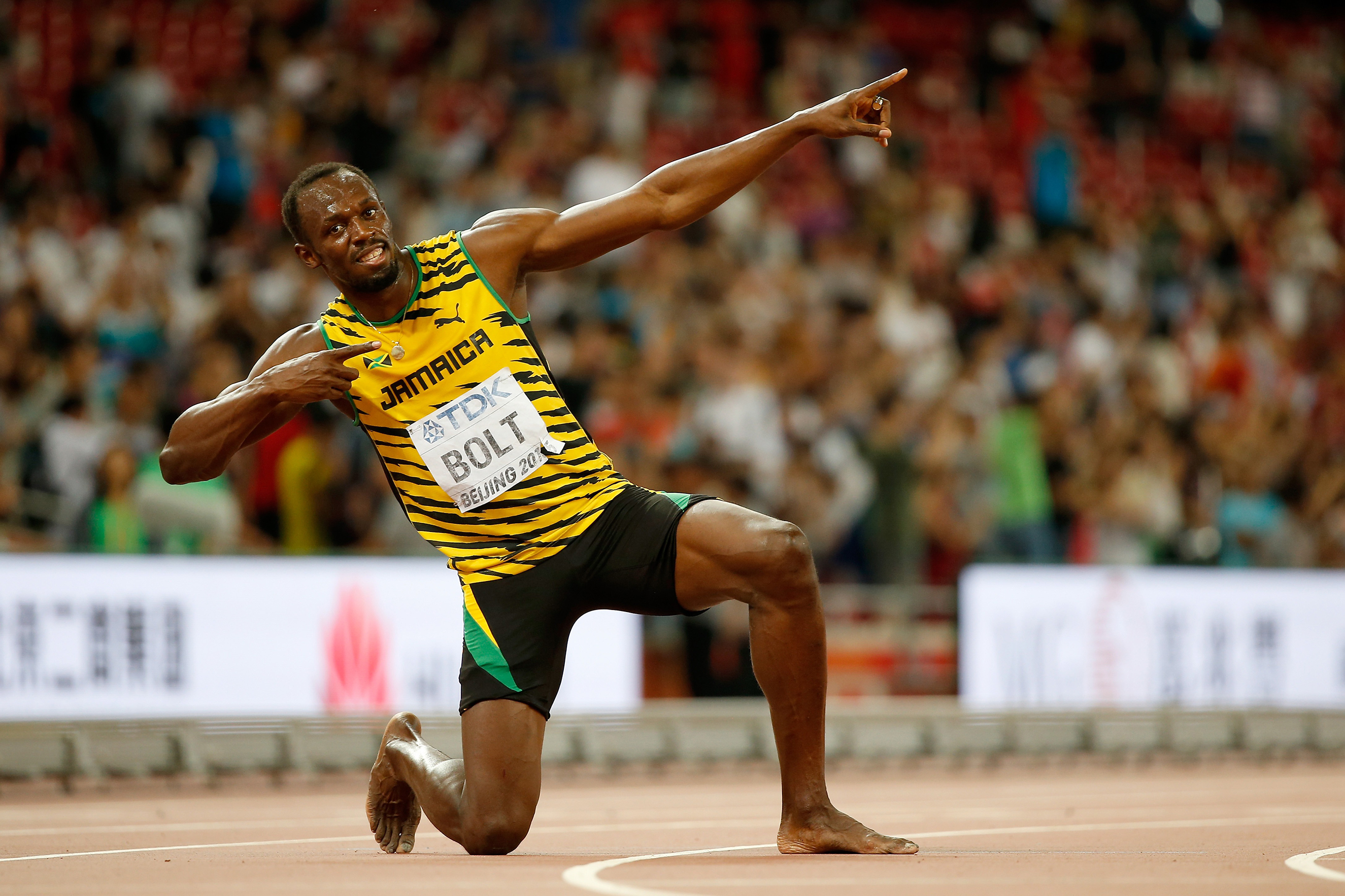 Bolt makes football debut, tires quickly