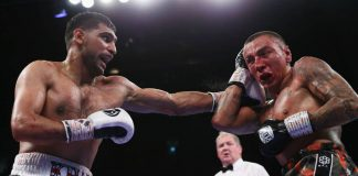 Amir Khan survives second-round knockdown to defeat Vargas