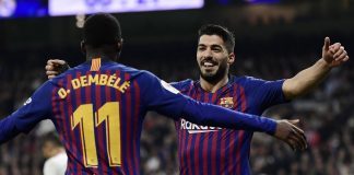 Suarez double downs Madrid to send Barca into Cup final