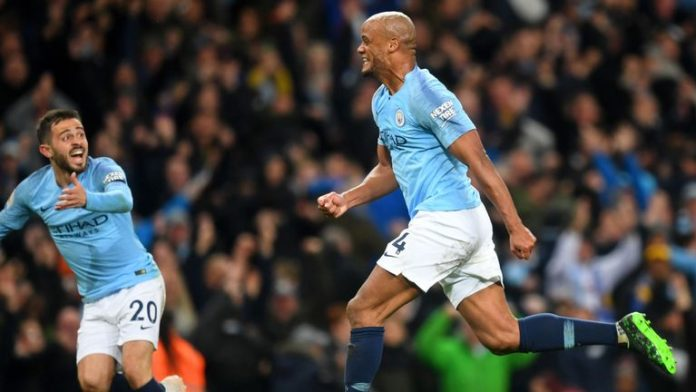 Kompany stunner moves Manchester City one win away from title